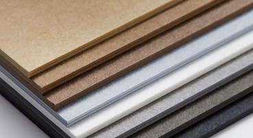 Recycled paper fibres material
