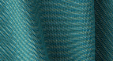 Materiale in fibra polimerica riciclata, lana e fibre di faggio