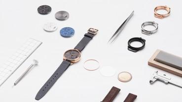 Orologio con materiali circolari