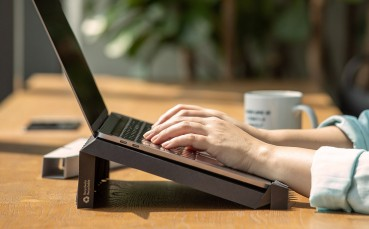 A portable laptop holder made of recycled paper
